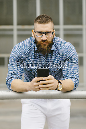 portrait of bearded hipster businessman with