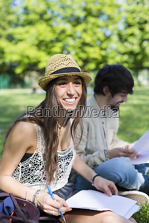 portrait of happy young student sitting