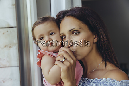 mother looking out of window with