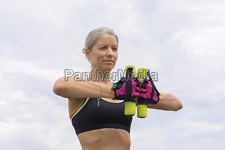 mature woman doing workout with dumbbells