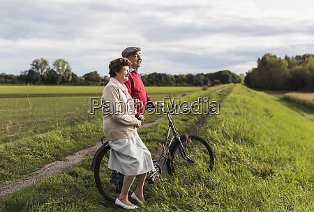 senior couple with bicycles in rural