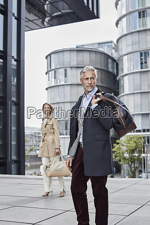 germany duesseldorf two fashionable business people