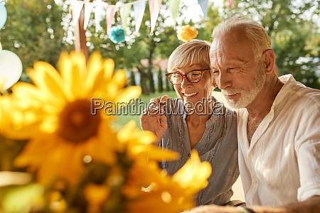 happy senior couple embracing on a