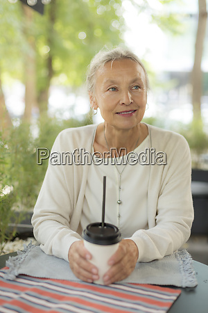 smiling senior woman at an outdoor