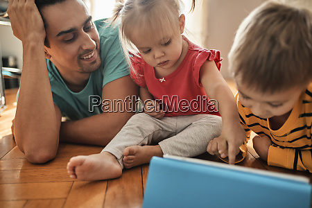 father and his children using digital