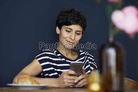 smiling woman at home sitting at