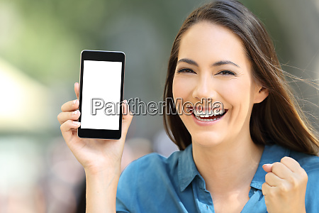 excited woman showing a blank phone