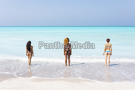 young women standing at the sea