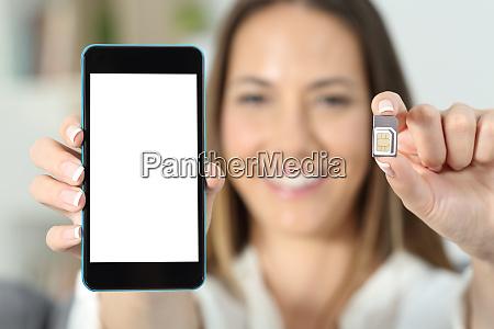 woman hand showing a sim card