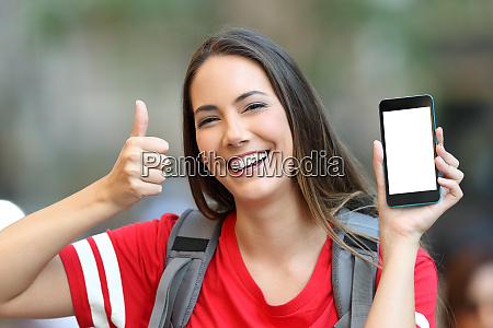 teen showing a smart phone screen
