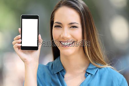 girl looking at camera showing a