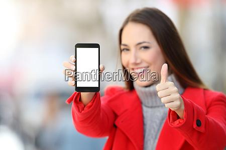 woman showing smart phone screen in