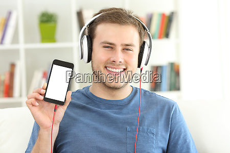 man listening music showing blank smart