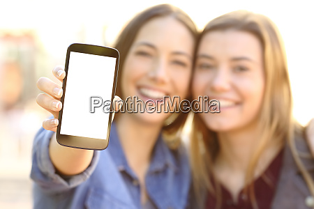 happy friends showing a blank phone