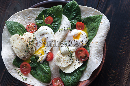 tortilla sandwiches with poached eggs