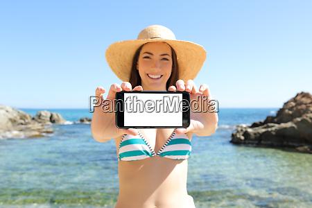 tourist showing blank horizontal phone screen