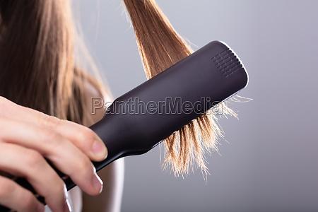 cabello queratina tratamiento alisado fuerte peinado