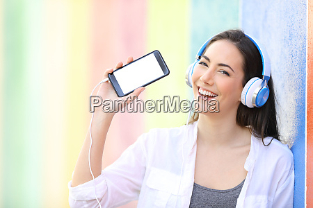 happy girl listening to music showing