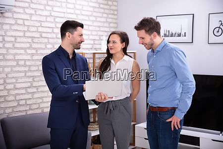 realtor showing new house to couple