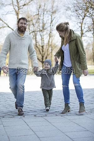 happy parents walking hand in hand