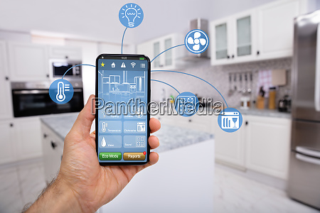 hand holding mobile with smart home