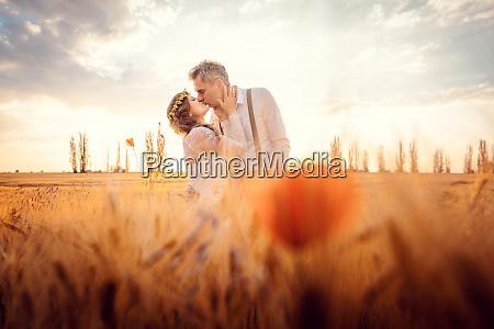 wedding couple kissing in romantic setting