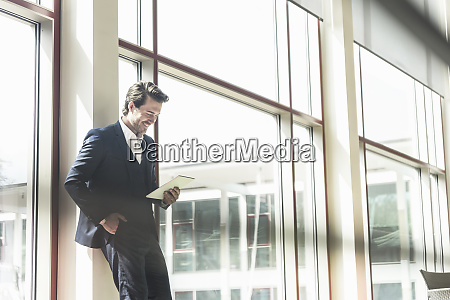 young businessman standing in office building