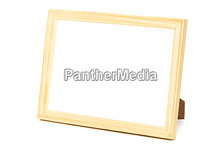 standing wooden picture frame on white
