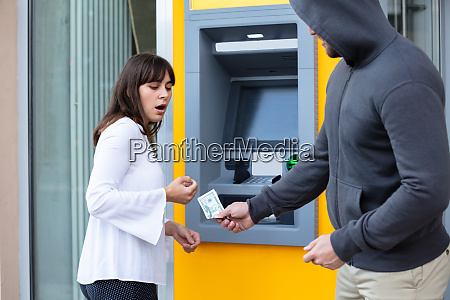 shocked woman looking at thief stealing
