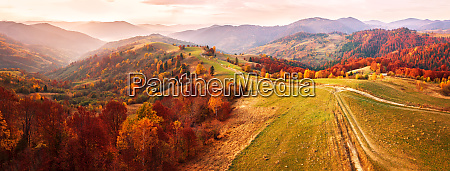 autumn mountain panorama dirt road on