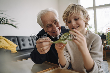 happy grandfather and grandson playing with