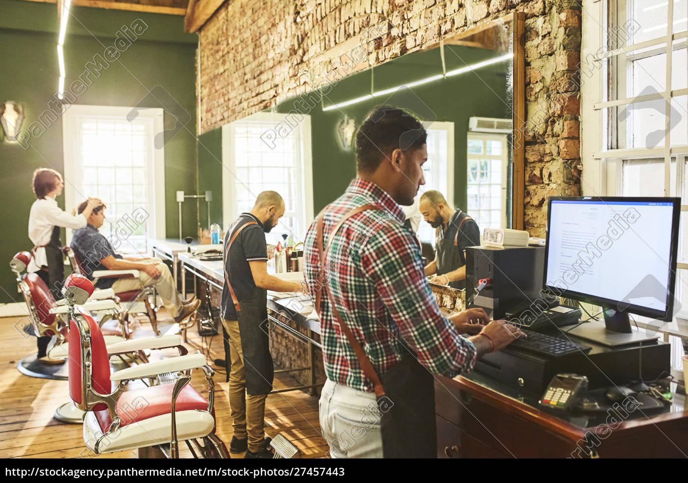male, barbers, working, in, barbershop - 27457443