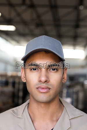 male worker looking at camera in