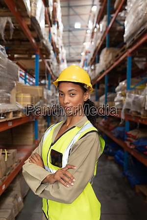 female worker standing with arms crossed