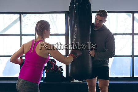 male trainer giving boxing training to