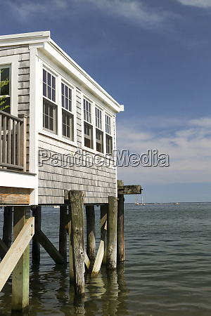 house on pilings on the water