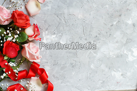 red roses and small white flowers