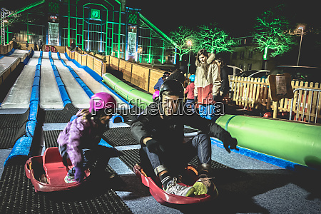 children, and, adults, tobogganing, on, an - 27959720