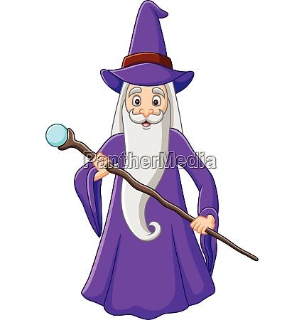 viejo mago de dibujos animados sosteniendo