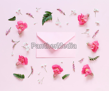 flowers and pink envelope on a