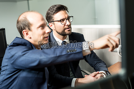 business team analyzing data at business