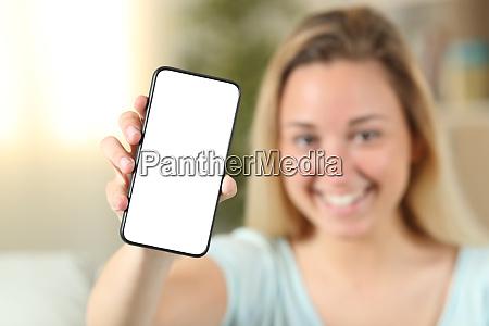 teenage girl presenting phone with blank