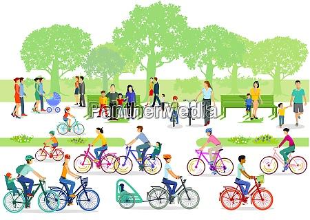 ciclistas y peatones en el parque
