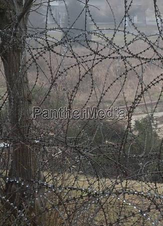 barbed, wire, fence, at, the, border - 28908686