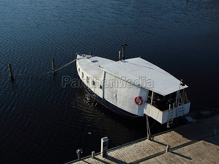isolated, boat, at, pier, in, aerial - 29743708